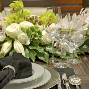 Yacht's dinner place setting with white roses