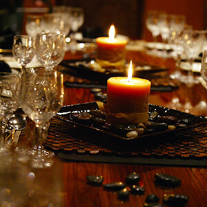 Yacht's candle lite setting with crystal wine glasses