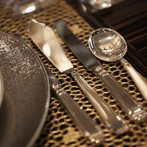 Elegant place setting with gold placemat